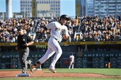 Jung Ho Kang runs around third base after hitting a home run during the fifth inning as the Pirates edged the San Francisco Giants, 3-2, Saturday at PNC Park.