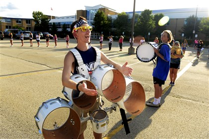 Senior Blaise Petrone, 17, a tenor drummer, yells instructions to the other drummers at the Canon-McMillan School District marching band camp Aug. 19.