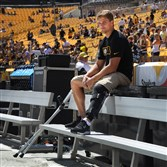 Steelers kicker Shaun Suisham uses crutches as he moves along the sideline before the preseason game Sunday against the Green Bay Packers. Suisham was injured in the first preseason game and had surgery on his knee.