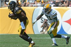 "Steelers' WR Markus Wheaton pulls in a pass against Packers' Ha Ha Clinton-Dix in the first quarter Sunday at Heinz Field. Wheaton is thought to be a quality ""sleeper"" pick in fantasy football drafts this season."