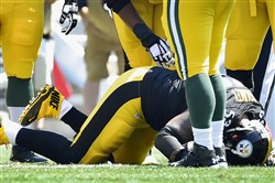 The Steelers' Maurkice Pouncey goes down with an injury against the Packers in the first quarter Sunday afternoon.