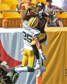 Steelers' Shakim Phillips pulls in a touchdown against Packers' Tay Glover-Wright in the fourth quarter Sunday at Heinz Field. He and former college teammate Tyler Murphy both caught touchdown passes in the Steelers' comeback win.