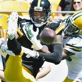 Packers cornerback LaDarius Gunter breaks up a pass intended for Steelers WR Martavis Bryant in the first half Sunday at Heinz Field.