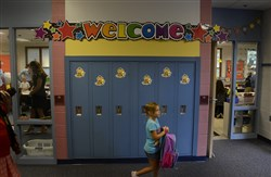 MacKenzy Linger looks for her locker at the start of  kindergarten orientation at  Bon Meade Elementary in the Moon School District.