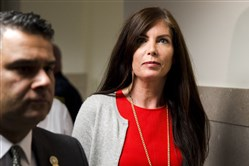 Pennsylvania Attorney General Kathleen Kane departs after her preliminary hearing Aug. 24 at the Montgomery County courthouse in Norristown, Pa.