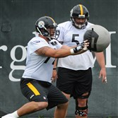 Pittsburgh Steelers center Cody Wallace, left, practice at the team's South Side facility as teammate Doug Legursky looks on on Tuesday, August 25, 2015.