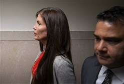 Pennsylvania Attorney General Kathleen Kane departs after her preliminary hearing Aug. 24 at the Montgomery County courthouse in Norristown.