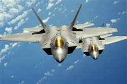The Pentagon said Thursday that two F-22 Raptors, like these ones flying near Andersen Air Force Base in Guam in 2010, were forced to take evasive actions after they were confronted by two Russian SU-25s over Syria.