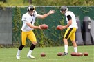 Punters Jordan Berry, left, and Brad Wing practice at the team's South Side facility Aug. 26.