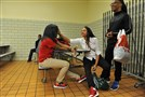 Wilkinsburg High School seniors, from left, Remy McIntyre, 17, Chelsea Martin, 18, and Anfrenee Fleming, 17, hang out in the cafeteria before the beginning of the first day of school Tuesday.