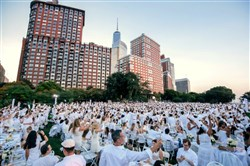 Guests dressed all in white take part in last year's Diner en Blanc in New York. Pittsburgh will hold its first Diner en Blanc on Sept. 11 at an undisclosed location.