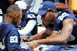 Anthony Payne, 6, left, who came with the Clairton Midget Football Organization, gets an autograph from Pitt Jr. WR Tyler Boyd, a Clairton alum, at Heinz Field for Pitt Fan Fest.