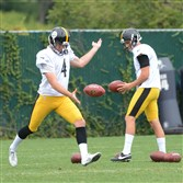 Punters Jordan Berry (4) and Brad Wing practice at the team's South Side facility Wednesday, August, 26, 2015.