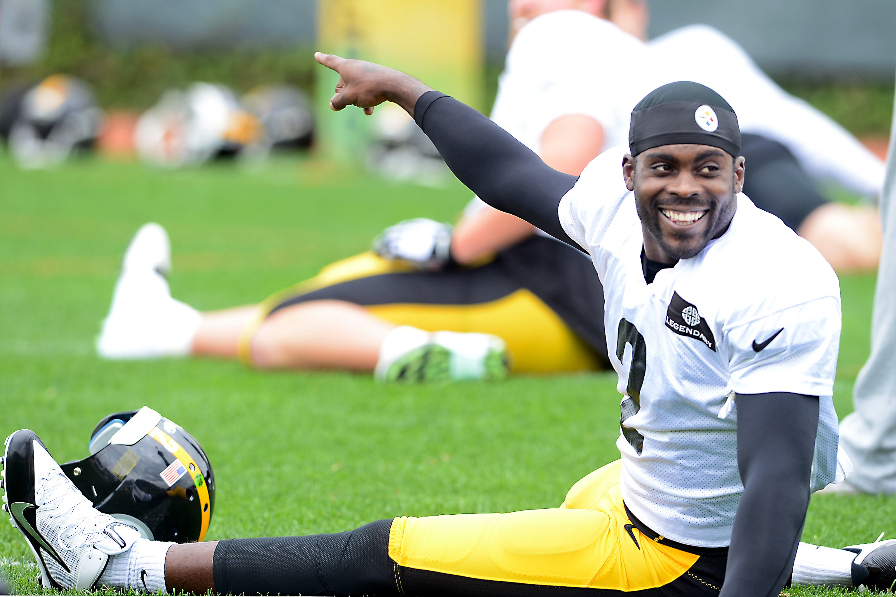 Quarterback Michael Vick practices with the Steelers at the team's South Side facility. His signing to the Pittsburgh football team has brought protests from many local animal lovers and animal groups.