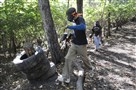 Players run for cover during a paintball game at Riverside Renegades Paintball in Squirrel Hill.