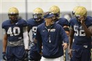 Pitt's head coach Pat Narduzzi instructs his team during workouts today on the South Side.