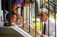 President Barack Obama greets residents in the the Treme neighborhood in New Orleans on Thursday for the 10th anniversary since the devastation of Hurricane Katrina.