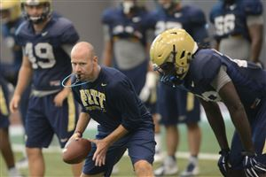 Pitt defensive coordinator Josh Conklin instructs players during practice at the team's South Side facility.