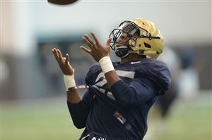 Pitt defensive back Pat Amara works on interception drills at the team's South Side facility.
