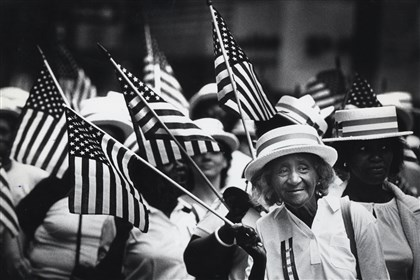 Alberta Tyson leads a large group of flag-waving laundry and dry cleaning workers from Local 141 during the 1984 Pittsburgh Labor Day Parade.