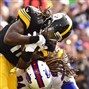 Steelers receiver Markus Wheaton takes big hit from Bills defender Stephon Gilmore against in the first quarter Saturday at Ralph Wilson Stadium in Orchard Park, New York.