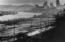 A view of the Almono redevelopment site near Hazelwood from the 1980s with the Birmingham Bridge and Pittsburgh skyline in the background. Once a sprawling coke works, in recent years a consortium of some of the region's leading foundations has been working on proposals to build as many as 1,200 housing units and more than 2 million square feet of office and research and development space at the 178-acre site.