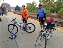 Paul Heckbert, left, of Edgewood and Yale Cohen of Squirrel Hill, after getting off the Capitol Limited in Connellsville Friday morning. The two were trying out Amtrak's planned new service that allows cyclists to roll their bikes onto the train without boxing them.