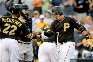 Pirates' Aramis Ramirez is congratulated by Andrew McCutchen after hitting a three-run home run against the Rockies in the first inning Saturday at PNC Park.