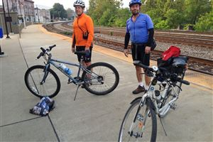Paul Heckbert of Edgewood and Yale Cohen of Squirrel Hill after getting off the Capitol Limited train in Connellsville on Friday morning. The two were trying out Amtrak's planned new service that allows cyclists to roll their bikes onto the train without boxing them.