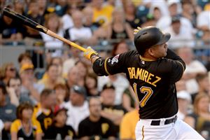 Pirates' Aramis Ramirez hits a three-run home run against the Rockies in the first inning Saturday at PNC Park.