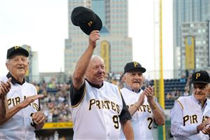 Bill Mazeroski acknowledges the crowd as the Pirates' 1960 World Series team is introduced Saturday before the start of the team's game against the Rockies at PNC Park.