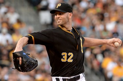 Pirates' J.A. Happ pitches against the Rockies Saturday at PNC Park.