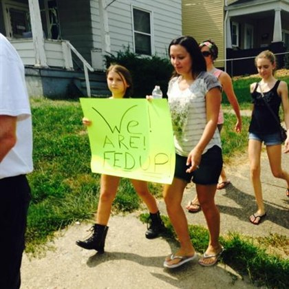 Marchers protest the recent spike in heroin overdoses in Washington County.