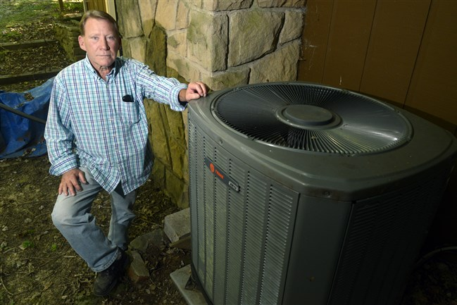 Bob Kramer with his heat pump at his Economy home. He recently discovered he has been in the wrong rate class for electric heating for 14 years, as a previous homeowner had installed a heat pump . Mr. Kramer has filed a formal compliant with the Pennsylvania PUC.