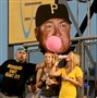 Pirates fans display a bubble gum chewing Clint Hurdle sign during their team's game against the Rockies Saturday at PNC Park.