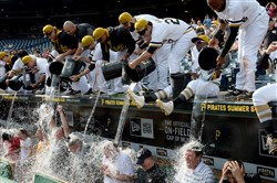 Pirates players douse fans, along with team general manager Neal Huntington, third from right, and president Frank Coonelly, second from right, during an Ice Bucket Challenge after a game at PNC Park in Aug. 2015. The event was part of ALS Awareness Month.