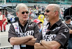 David Letterman, left, and Bobby Rahal, car owners for driver Oriol Servia, of Spain, talk before the 93rd running of the Indianapolis 500 auto race at the Indianapolis Motor Speedway in Indianapolis.