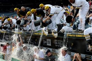 Pirates players douse fans, along with team general manager Neal Huntington, third from right, and president Frank Coonelly, second from right, during an ice bucket challenge after the team's game against the Rockies on Sunday at PNC Park. The event was part of ALS Awareness Month.