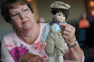"Susan Crabill of Newcastle gets ""Frederick"" the doll appraised during the event."