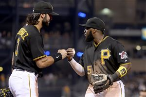 Sean Rodriguez celebrates with Josh Harrison after completing a double play to end the game, giving the Pirates a 4-3 victory over the Rockies Saturday at PNC Park.