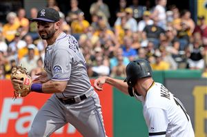 The Rockies' Daniel Descalso retires the Pirates' Jordy Mercer at second base in the third inning Sunday at PNC Park.