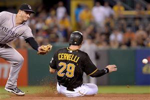 Pirates' Francisco Cervelli slides into second base on a throwing error by the Rockies' Ben Paulsen in the fourth inning Saturday at PNC Park. Cervelli advanced to third on the play.