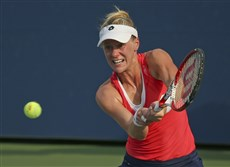 Peters Township native Alison Riske returns a shot in a first-round match Monday against Eugenie Bouchard of Canada. Riske lost in straight sets, 6-4, 6-3.
