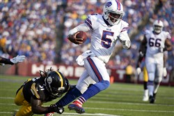 Tyrod Taylor gets past former Steelers linebacker Sean Spence on a touchdown run during the second half of a preseason NFL football game on Saturday, Aug. 29, 2015, in Orchard Park, N.Y.