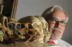 Jeffrey Schwartz, with human and monkey skulls, in a lab at the University of Pittsburgh's Posvar Hall, in 2009.
