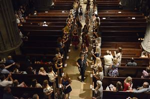 People line the aisle of the Heinz Chapel at the ceremony.
