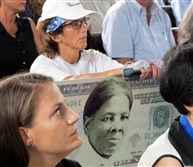 A woman holds a sign supporting Harriet Tubman for the $20 bill, during a town hall meeting at the Women's Rights National Historical Park in Seneca Falls, N.Y. Although the meeting with U.S. Treasurer Rosie Rios was part of plans to redesign the $10 bill, several in attendance said they wanted to see a woman on the $20 bill.