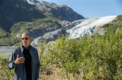 President Barack Obama speaks to reporters Tuesday while hiking to the Exit Glacier in Seward, Alaska.