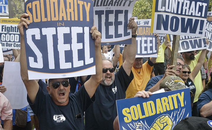 20150901lruswlocal16-15 Steelworkers attending a rally at USW headquarters calling for fair labor contracts chant slogans. Those attending the rally later marched to ATI and USS headquarters.