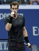 Andy Murray of Britani clenches his fist after defeating Nick Kyrgios of Australia, 7-5, 6-3, 4-6, 6-1, in the first round of the U.S. Open tennis tournament in New York.